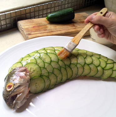 Leaping Poached Trout with Cucumber Scales