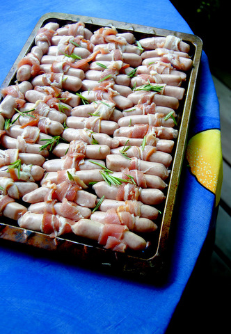 Bacon-wrapped pork chipolatas, ready for the oven